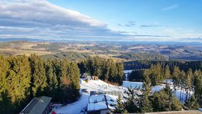 Vista from The Trail Trees Lipno Lookout, Czechia. View of a skiing slope from the Lipno Treetop Walk in winter, a unique vista from among the trees in the South Royalty Free Stock Photography