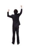 A vista traseira dos braços aumentou o homem de negócio Imagem de Stock