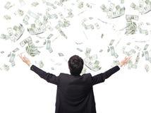 Dinero del abrazo del hombre de negocios Imágenes de archivo libres de regalías