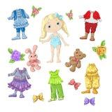 Vista uma boneca bonito com grupos de roupa com acessórios e brinquedos Imagens de Stock Royalty Free