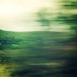 Vista vaga através de janela de carro movente - filtro do vintage Fotografia de Stock Royalty Free