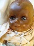 Vista velha da cara da boneca Fotografia de Stock