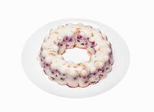 Vista vicina di un dolce variopinto della gelatina con vari frutti dentro Immagini Stock