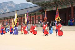 Vistiors waiting for the ceremony to change the guards at the Gyeongbokgung Palace Stock Images