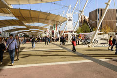 Vistitors crowd walk under Decumano tensile membrane structure,. MILAN, ITALY - October 07, EXPO 2015, a crowd of visitors walks under the  tensile membrane Stock Photo