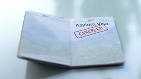 Visto cancelado, selo do asilo carimbado no passaporte, viajando no exterior, imigração fotografia de stock