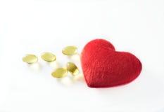 Vistraancapsules met rood hart Royalty-vrije Stock Foto