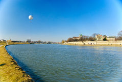 Vistula boulevards with flying balloon and St. Sta Royalty Free Stock Image