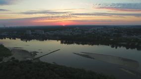 The Vistula River at sunrise and the awakening city, AERIAL FOOTAGE. The Vistula River at sunrise and the awakening city, morning in the city, colorful clouds stock video