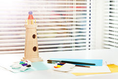 Visual art lesson at the kindergarten or school. Stationery set and wooden model of tower for visual art lesson at the kindergarten or school Royalty Free Stock Photography