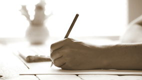 Visual artist sketching something with a gray pencil