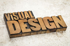 Visual design in wood type. Visual design text in vintage letterpress wood type on a ceramic tile background stock photo