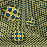 Visual illusion illustration. Three balls are moving on in the yellow blue expanding corner. Abstract polka dots fantasy in a surreal style Royalty Free Stock Images