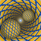 Visual illusion illustration. Two balls are moving on rotating blue funnel with yellow rhombuses. Royalty Free Stock Images