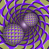 Visual illusion illustration. Two balls are moving on rotating mottled blue purple green hole. Stock Images
