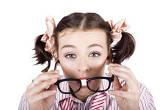 Visual Impaired Woman Trying To Read With Glasses Royalty Free Stock Photos