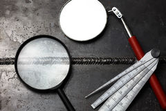 Visual test. Visual inspection tool for test weldment royalty free stock images