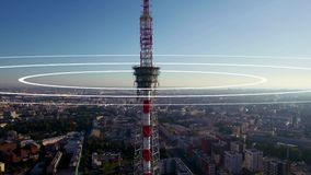 Visualization of radio waves coming from a large TV antenna towering above the city. Concept visualization of a phone stock footage