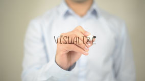 Visualize, Man Writing on Transparent Screen. High quality Royalty Free Stock Photo