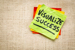 Visualize success advice  on sticky note. Visualize success advice - handwriting on a sticky note against burlap canvas Stock Photos
