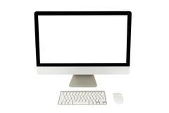 Visualizzatore del computer con lo schermo in bianco e la tastiera senza fili Fotografie Stock