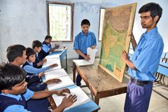Indian Blind Student At Geography Class. Visually impaired Indian student learning at the geography class room in the Louis Braille-blind school at West Bengal royalty free stock photo