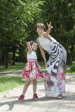 Vitória do mum e da filha Foto de Stock Royalty Free