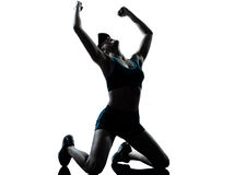 Vitória do vencedor do ajoelhamento do basculador do corredor da mulher Foto de Stock