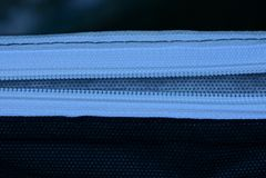 Vit öppen vinande på svart tyg från ett stycke av kläder royaltyfria foton