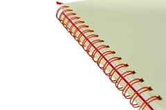 Vit anteckningsbok som isoleras på vit Royaltyfria Foton