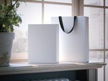 Vit ask och shoppingpåse på en fönsterfönsterbräda framförande 3d Arkivbild