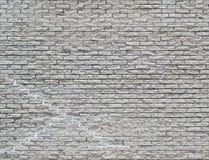 Vit bakgrund för tegelstenvägg med sprickor och reparationer som upprepar PA Royaltyfria Bilder