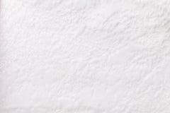 Vit bakgrund från ett mjukt stoppningtextilmaterial, closeup Arkivbild
