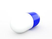 Vit-blått capsule på viten Arkivfoton