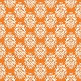 Vit blom- sömlös design på orange bakgrund Arkivfoto
