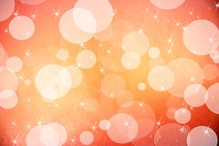 Vit bokeh på orange bakgrund Arkivbilder