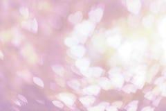 Vit bokeh på rosa bakgrund Royaltyfri Foto