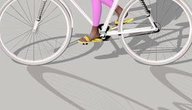 Vit cykel på grå färger Arkivbilder