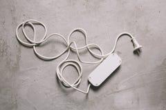 Vit elektrisk förlängningskabel Fotografering för Bildbyråer