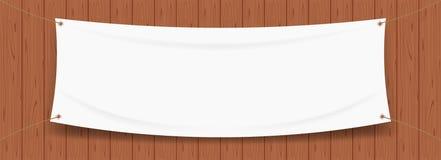 Vit för vinylbanermellanrum som isoleras på trärambakgrund, vit åtlöje upp textiltyg som är tomt för banret som annonserar royaltyfri illustrationer