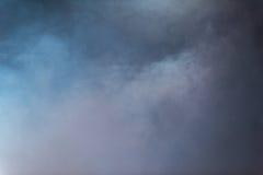Vit fördunklar på blåttbakgrund Royaltyfria Bilder
