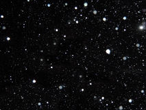 Vit fallande snö på en svart bakgrund Royaltyfria Bilder