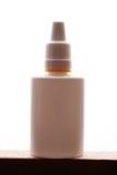 Vit flaska av nasala droppar på vit Fotografering för Bildbyråer