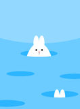Vit gullig kanin som kikar ut ur ett hål Närliggande mer hål, en nolla Royaltyfria Bilder