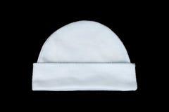 vit handarbeteull behandla som ett barn hatten som isoleras på svart Royaltyfri Foto