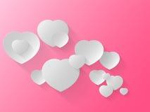Vit hjärta på en rosa bakgrund Arkivfoto
