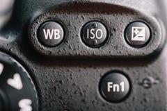Vit jämvikt, ISO och exponeringskompensationsknapp på Digital kamera arkivfoton