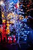Vit julgran med ljus Arkivfoto
