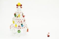 Vit julgran och lilla Santa Claus Fotografering för Bildbyråer