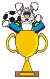 Vit kanin är i en guld- kopp i kängor och innehav en boll Royaltyfri Foto